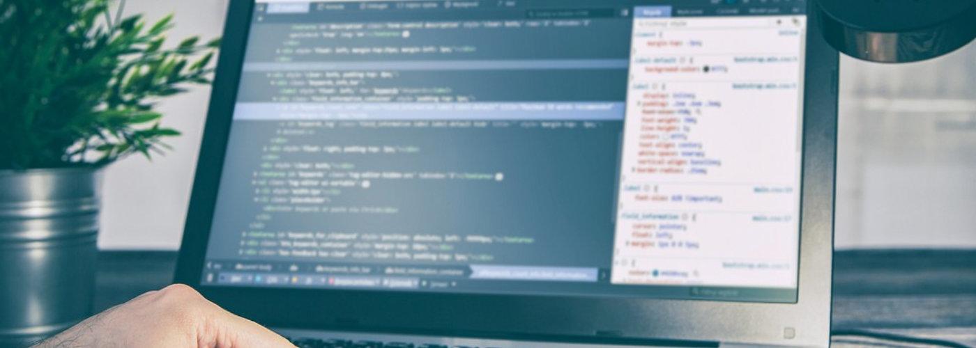 image of man coding